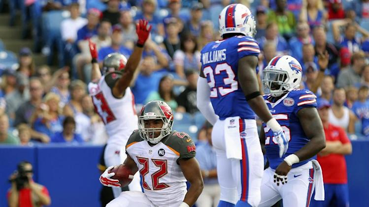 Tampa Bay Buccaneers running back Doug Martin (22) reacts after scoring a touchdown during the first half of a preseason NFL football game against the Buffalo Bills Saturday, Aug. 23, 2014, in Orchard Park, N.Y. (AP Photo/Bill Wippert)