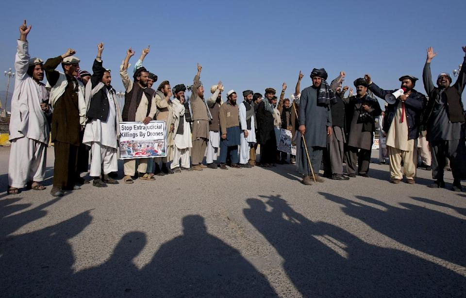 Pakistani tribal villagers hold a poster showing children killed in the allegedly U.S. drone attacks during a rally near parliament house in Islamabad, Pakistan on Saturday, Feb, 25, 2012. Dozens of tribal villagers form Waziristan region rallied in the capital Islamabad against drone attacks in Pakistani tribal areas. (AP Photo/Anjum Naveed)