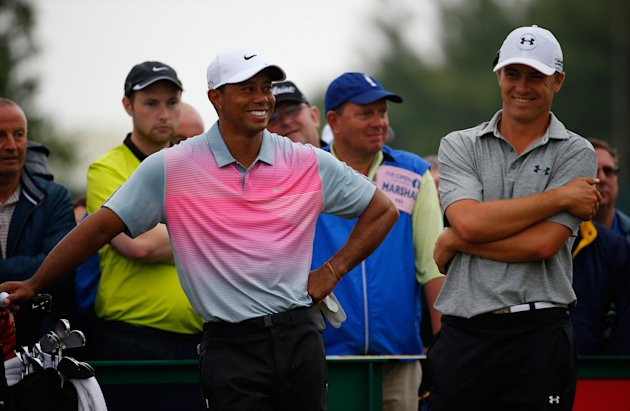 HOYLAKE, ENGLAND - JULY 19: Tiger Woods of the United States shares a joke with Jordan Spieth of the United States (R) during the third round of The 1...