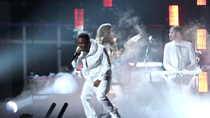 FILE - In this Jan. 26, 2014 file photo, Kendrick Lamar performs at the 56th annual Grammy Awards at Staples Center, in Los Angeles. Lamar is taking a philosophical approach to being shut out at the Grammy Awards. Lamar, one of Sunday night's top nominees with seven nods, was shut out, prompting four-time winner Macklemore to send a text of apology later that night after winning best rap album. (Photo by Matt Sayles/Invision/AP, File)