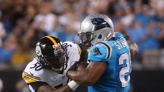 Carolina Panthers' Jonathan Stewart (28) is forced out of bounds by Pittsburgh Steelers' Ryan Shazier (50) during an NFL football game Sunday, Sept. 21, 2014, in Charlotte, N.C