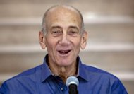 Former Israeli prime minister Ehud Olmert speaks to the press at the District Court in Jerusalem on July 10, 2012 after hearing the verdict in his trial where he was acquitted on two key corruption charges while finding him guilty on a lesser charge. AFP PHOTO/POOL/ARIEL SCHALIT