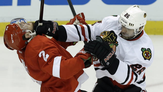 Chicago Blackhawks center Michal Handzus (26), of the Czech Republic, checks Detroit Red Wings defenseman Brendan Smith (2) during the second period in Game 4 of the Western Conference semifinals in the NHL hockey Stanley Cup playoffs in Detroit, Thursday, May 23, 2013. (AP Photo/Paul Sancya)