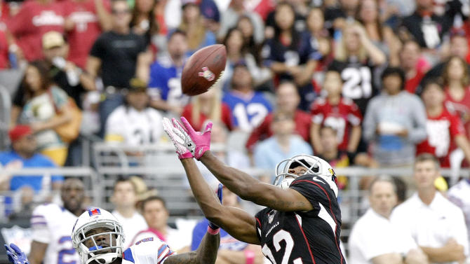 Arizona Cardinals wide receiver Andre Roberts (12) cannot make the catch as Buffalo Bills cornerback Terrence McGee (24) defends during the first half of an NFL football game on Sunday, Oct. 14, 2012, in Glendale, Ariz.  (AP Photo/Rick Scuteri)