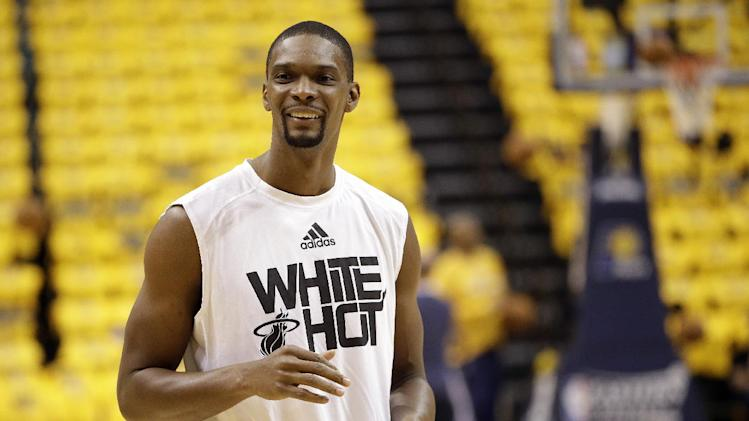 Miami Heat's Chris Bosh smiles as he warms up for game 1 of the Eastern Conference finals NBA basketball playoff series against the Indiana Pacers Sunday, May 18, 2014, in Indianapolis
