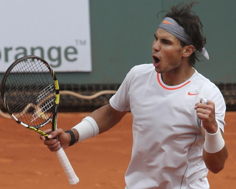 Spain's Rafael Nadal celebrates defeating Germany's Daniel Brands in their first round match of the French Open tennis tournament, at Roland Garros stadium in Paris, Monday, May 27, 2013. Nadal won in four sets 4-6, 7-6, 6-4, 6-3. (AP Photo/Michel Euler)