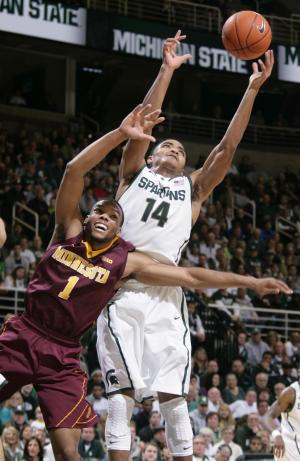 Michigan State's Gary Harris (14) and Minnesota's Andre Hollins (1) reach for a rebound during the first half of an NCAA college basketball game, Saturday, Jan. 11, 2014, in East Lansing, Mich. (AP Photo/Al Goldis)