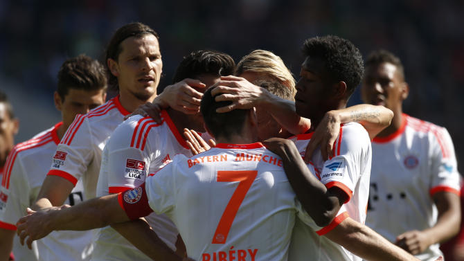 Bayern's Franck Ribery, center, of France is celebrated by his teammates after scoring his side's 2nd goal during the German first division Bundesliga soccer match between Hannover 96 and FC Bayern Munich in Hannover, Germany, Saturday, April 20, 2013. (AP Photo/Markus Schreiber)