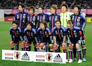 File photo shows Japan&#39;s players posing for a photo prior to a match at Kirin Challenge Cup in Sendai, Japan, in April. It has been revealed that Japan&#39;s world champion women footballers were seated in premium economy while their male colleagues enjoyed business class on a flight to Europe for the Olympics
