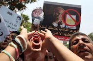 Egyptians chant slogans against presidential candidate and former premier Ahmed Shafiq during a protest outside the Constitutional Court in Cairo