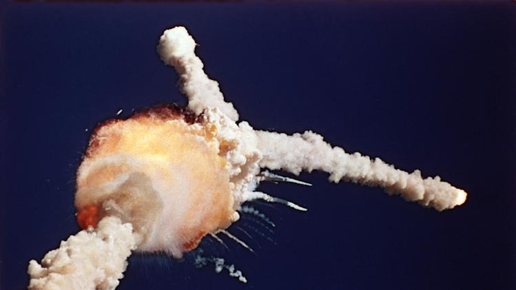 FILE - In this Jan. 28, 1986 file photo, the space shuttle Challenger explodes shortly after lifting off from the Kennedy Space Center in Cape Canaveral, Fla. (AP Photo/Bruce Weaver, File)