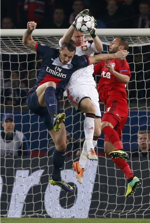 Paris St Germain's Ibrahimovic challenges Bayer Leverkusen's Leno and Bayer Leverkusen's Toprak during their Champions League round of 16 second leg soccer match at the Parc des Princes St
