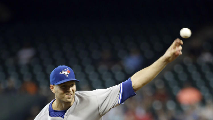 Toronto Blue Jays starting pitcher J.A. Happ throws against the Houston Astros during the first inning of a baseball game Friday, Aug. 1, 2014, in Houston. (AP Photo/David J. Phillip)