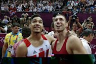 Hungary's Krisztian Berki (R) and Great Britain's Louis Smith pose at the end of of the men's pommel horse final of the artistic gymnastics event of the London Olympic Games at the 02 North Greenwich Arena in London. Berki won the gold and Smith the silver