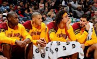 Antawn Jamison, Anthony Parker, Anderson Varejao and Omri Casspi of the Cleveland Cavaliers sit on the bench during a game earlier this season. Jamison scored 21 points and Parker added 14 as struggling Cleveland shocked NBA leaders Oklahoma City 96-90