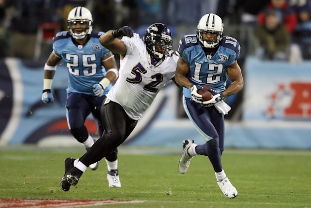 NASHVILLE, TN - JANUARY 10: Wide receiver Justin Gage #12 of the Tennessee Titans looks to avoid a tackle by Ray Lewis #52 of the Baltimore Ravens in the second quarter during the AFC Divisional Playo