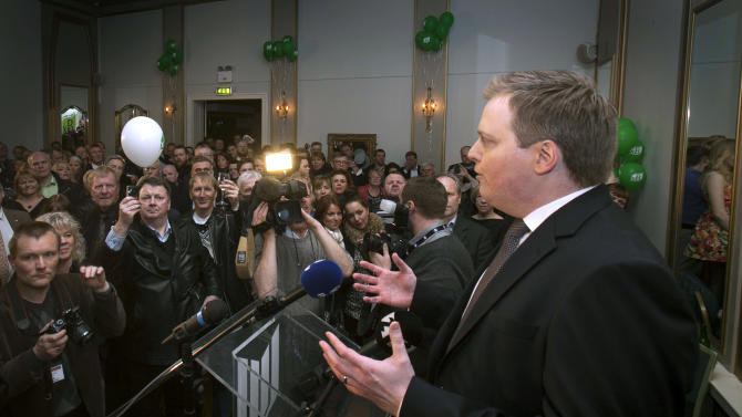 Progressive Party chief Sigmundur David Gunnlaugsson speaks to supporters following general elections on Saturday, April 27, 2013, in Reykjavik, Iceland. Five years after Iceland's economic collapse, early returns signaled that voters are favoring the return of a center-right, Eurosceptic government, widely blamed for the nation's financial woes. (AP Photo/Brynjar Gauti)