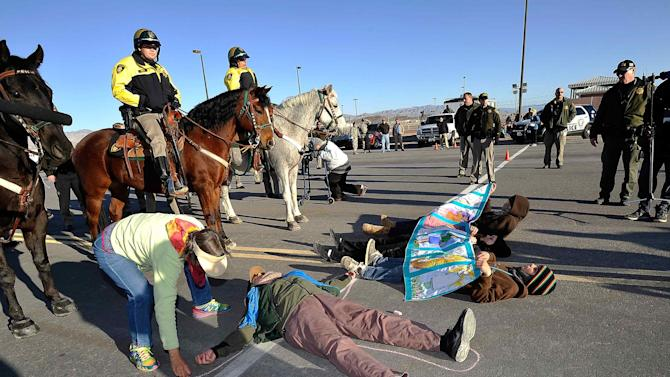 Las Vegas mounted police stand guard as members and supporters of the activist group Code Pink stage a peace march and civil resistance outside Creech Air Force Base in Clark County, Nevada