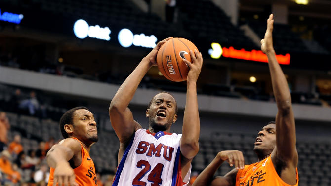 SMU forward Robert Nyakundi (24) drives to the basket between Oklahoma State guard Brian Williams (4) and forward Jean-Paul Olukemi (0)in the second half of an NCAA college basketball game in Dallas, Wednesday, Dec. 28, 2011. Oklahoma St won 68-58. (AP Photo/Matt Strasen)