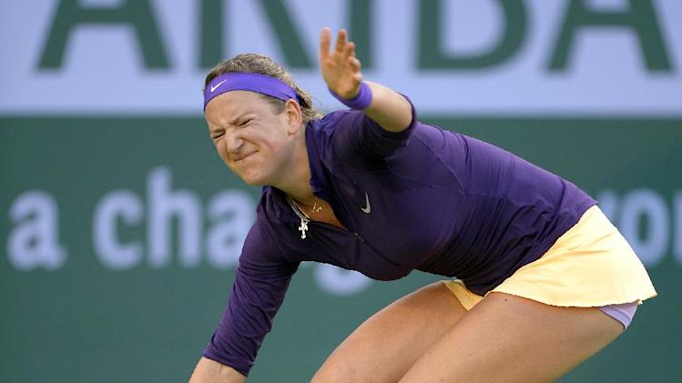 Victoria Azarenka, of Belarus, winces after returning a shot to Urszula Radwanska, of Poland, during their match at the BNP Paribas Open tennis tournament, Tuesday, March 12, 2013, in Indian Wells, Calif. (AP Photo/Mark J. Terrill)
