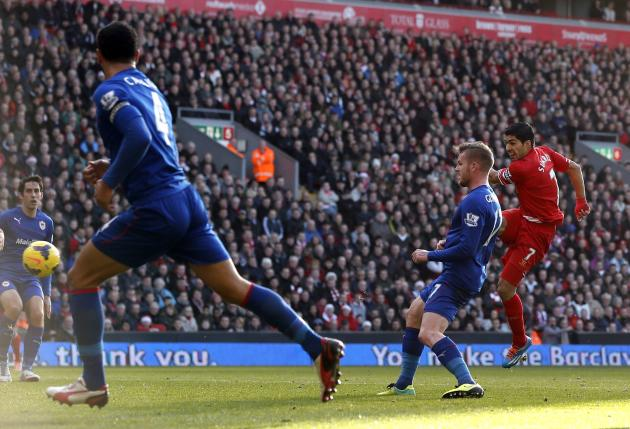Liverpool's Suarez scores a goal against Cardiff City during their English Premier League soccer match at Anfield in Liverpool