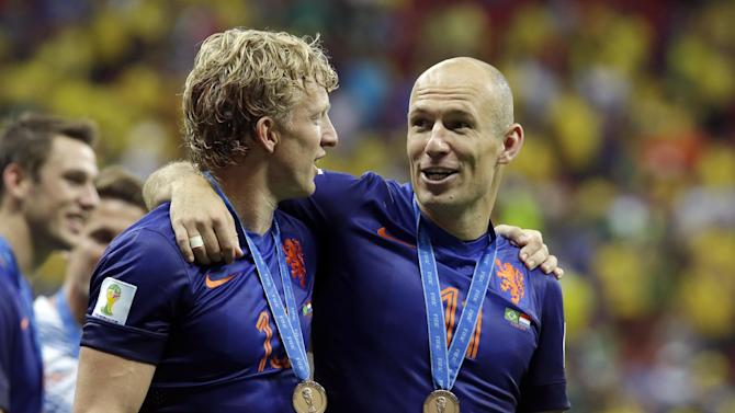 Netherlands' Dirk Kuyt, left, and Arjen Robben celebrate after the World Cup third-place soccer match between Brazil and the Netherlands at the Estadio Nacional in Brasilia, Brazil, Saturday, July 12, 2014. The Netherlands won the match 3-0
