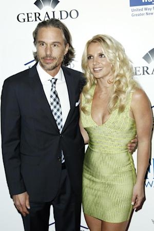 """FILE - In this May 11, 2011 file photo, singer Britney Spears, right, and Jason Trawick arrive at an Evening of """"Southern Style"""" in Beverly Hills, Calif. Trawick announced Friday, dec. 16, 2011, on """"Access Hollywood"""" that he and Spears are engaged. The two have been dating since 2009. (AP Photo/Matt Sayles, file)"""