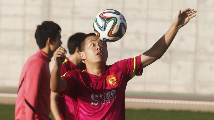 Huang of China's Guangzhou Evergrande attends a training session in Agadir Stadium