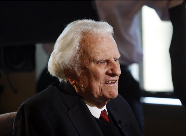 In this Dec. 20, 2010 file photo, evangelist Billy Graham speaks to the media at the Billy Graham Evangelistic Association headquarters in Charlotte, N.C. A spokesman for Graham says the 93-year-old evangelist has been admitted to a North Carolina hospital for an infection in his lungs. A joint statement Sunday, Aug. 12, 2012, from Graham's spokesman and Mission Hospital says Graham was admitted overnight for evaluation and treatment of an infection thought to be bronchitis. The hospital is in Asheville, near his home in Montreat.