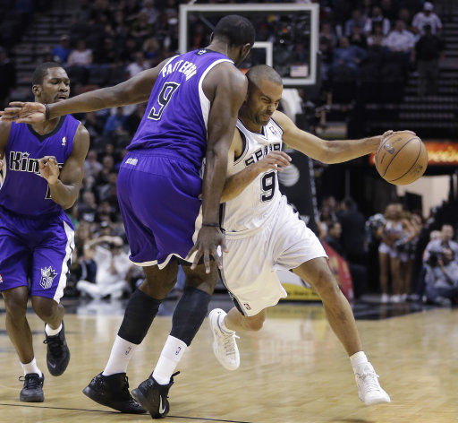 San Antonio Spurs' Tony Parker, right, of France, drives around Sacramento Kings' Patrick Patterson, left, during the first half of an NBA basketball game on Friday, March 1, 2013, in San Antonio. (AP Photo/Eric Gay)