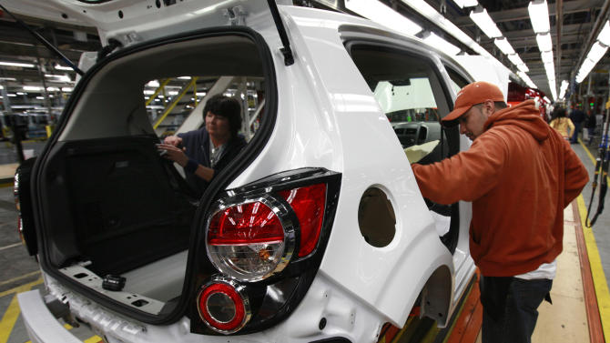 In this May 19, 2011 photo, line workers assemble a pre-production Chevrolet Sonic at the General Motors Orion Assembly plant in Orion Township, Mich. Businesses boosted their orders for machinery, electronics products and airplanes in May after a big cutback in the previous month. (AP Photo/Paul Sancya)