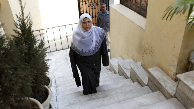 In this Thursday, Oct. 4, 2012 photo, Sabah al-Saqari, 49, a senior member of the Freedom and Justice Party, the political arm of the Muslim Brotherhood, arrives at her office in the FJP's headquarters in Cairo, Egypt. For the first time, a woman is running for the leadership of the political party of the Muslim Brotherhood, Egypt's most powerful Islamist group. Sabah al-Saqari says she wants to increase female participation in politics and even defends a woman's right to run for president, a stance her organization rejects. But liberals who fear Islamist rule will set back women's rights say her candidacy is just an attempt by the Brotherhood to improve its image.  (AP Photo/Nasser Nasser)