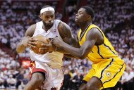 Miami Heat's LeBron James (L) drives on Indiana Pacers' Lance Stephenson during Game 1 of their NBA Eastern Conference final basketball playoff in Miami, Florida May 22, 2013. REUTERS/Joe Skipper (UNITED STATES - Tags: SPORT BASKETBALL)