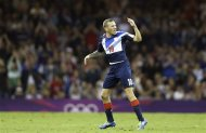Britain's Craig Bellamy gestures as he leaves the field during the men's group A soccer match between Britain and Uruguay, at the Millennium Stadium in Cardiff, Wales, at the 2012 London Summer Olympics, Wednesday, Aug. 1, 2012. (AP Photo/Luca Bruno)