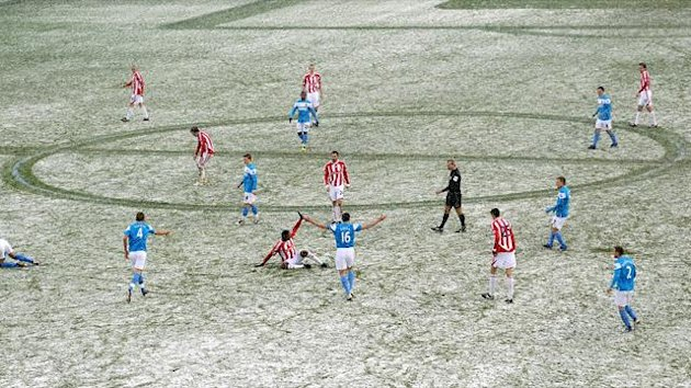 A snowy football match