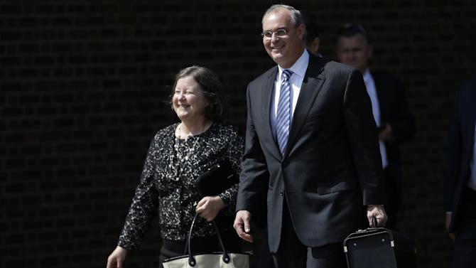 Attorney David Frederick, right, accompanied by Mary Ann Easterling, the widow of former NFL player Ray Easterling, walks from the U.S. Courthouse Tuesday, April 9, 2013, in Philadelphia, after a hearing to determine whether the NFL faces years of litigation over concussion-related brain injuries. Thousands of former players have accused league officials of concealing what they knew about the risk of playing after a concussion. The lawsuits allege the league glorified violence as the game became a $9 billion-a-year industry. (AP Photo/Matt Rourke)