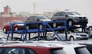 A truck transports cars made by South Korea's Hyundai Motor Group in Pyeongtaek