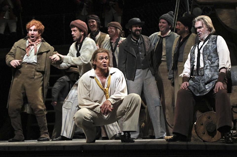 "In this Wednesday, May 2, 2012 photo, Nathan Gunn, center, performs the title roll during the final dress rehearsal of Benjamin Britten's ""Billy Budd"" at the Metropolitan Opera in New York.  (AP Photo/Mary Altaffer)"