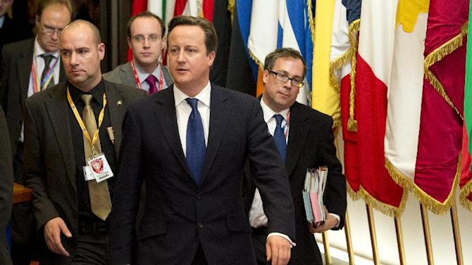 British Prime Minister David Cameron, center, departs after an EU summit in Brussels on Friday, Nov. 23, 2012. The leaders of Britain and France staked out starkly different visions of Europe's future as talks in Brussels on how much the European Union should be allowed to spend, set the stage for a long, divisive and possibly inconclusive summit. (AP Photo/Geert Vanden Wijngaert)