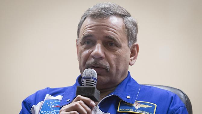 Russian cosmonauts  Mikhail Korniyenko, crew member of the mission to the International Space Station, ISS, speaks during a news conference in the Russian leased Baikonur cosmodrome, Kazakhstan, Thursday, March 26, 2015.  The start of the new Soyuz mission is scheduled on Saturday, March 28.(AP Photo/Dmitry Lovetsky)