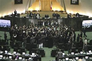 Members of the Iranian parliament shout slogans calling for the execution of opposition leaders before the start of their session in Tehran