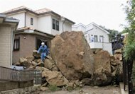 Rocks are seen in a residential area following a landslide caused by Typhoon Wipha in Kamakura, south of Tokyo, in this photo taken by Kyodo October 16, 2013. Mandatory Credit REUTERS/Kyodo