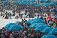 A general view shows holiday-makers on a beach at the seaside town of Beidaihe, 285 km east of Beijing, on August 6. China&#39;s leaders, including the man expected to be the next president, have begun their secretive summer meetings at the resort, state press said on August 5, ahead of a once-in-a-decade transition of power