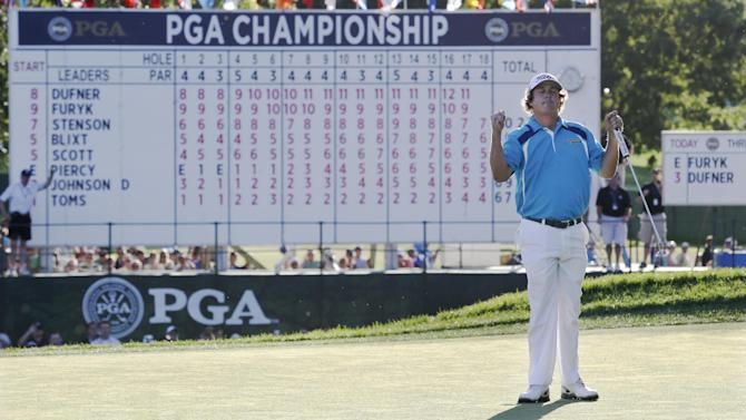 Jason Dufner celebrates after winning the PGA Championship golf tournament at Oak Hill Country Club, Sunday, Aug. 11, 2013, in Pittsford, N.Y. (AP Photo/Julio Cortez)