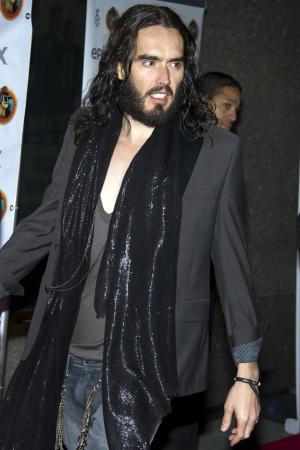 """Russell Brand arrives to Amnesty International's """"Secret Policeman's Ball"""" in New York, Sunday, March 4, 2012. (AP Photo/Charles Sykes)"""