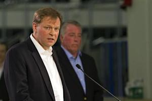 Frank Fischer makes remarks at a news conference in Chattanooga
