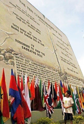 A boy looks at the world's largest tablet of the ten commandments on display in Baguio City, north of Manila