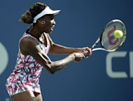 Venus Williams of the US returns to compatriot Bethanie Mattek-Sands during their women&#39;s first round 2012 US Open match at the USTA Billie Jean King National Tennis Center in New York. Williams won 6-3, 6-1