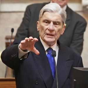 FILE - In this Wednesday Jan. 18, 2012 file photo, former US Senator John Warner speaks on the floor of the House of Delegates at the Capitol in Richmond, Va. On Monday, Jan. 27, 2014, Warner endorsed his Democratic successor, Sen. Mark Warner, who is being challenged by Ed Gillespie in in Virginia's U.S. Senate race. The Warners are not related.This is the first time he has endorsed a Democrat outright. (AP Photo/Steve Helber, File)