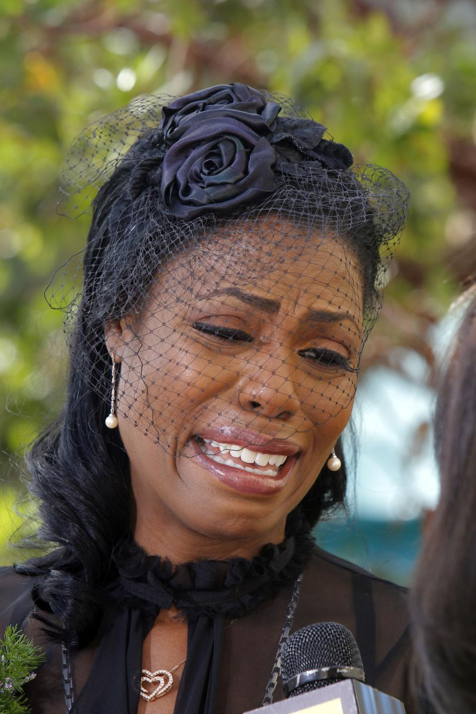 Michael Clarke Duncan's fiancée Omarosa Manigault attends the Michael Clarke Duncan Memorial Service at Forest Lawn Memorial-Park and Mortuaries in the Hollywood Hills selection of Los Angeles Monday, September 10,  2012. (AP Photo/Nick Ut)